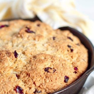 Best Ever Irish Soda Bread recipe is an absolute perfected version! It has a golden, crunchy, sweet crust with a moist, chewy interior, and tangy cranberries. www.mamagourmand.com