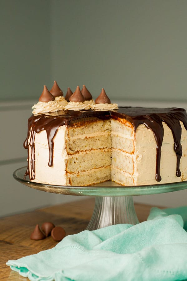 Peanut Butter Chunky Monkey Cake has fluffy peanut butter buttercream frosting, moist banana cake layers, and Nutella ganache. Best cake EVER! http://www.mamagourmand.com