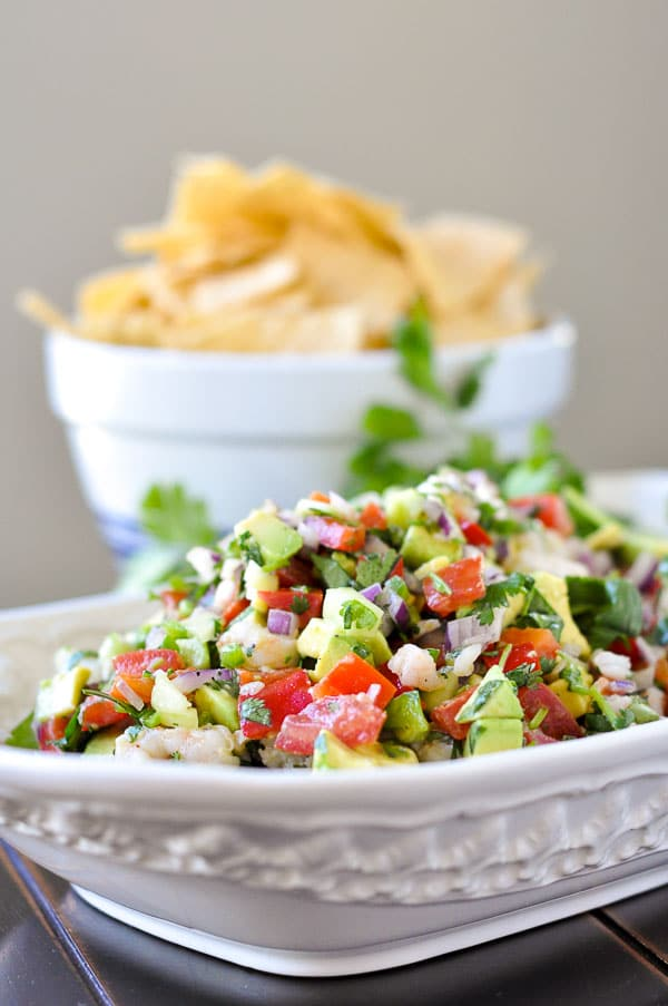 Totally Addictive Shrimp Avocado Salsa uses fresh garden ingredients and tosses together to make one surprisingly flavorful and addictive appetizer. http://www.mamagourmand.com