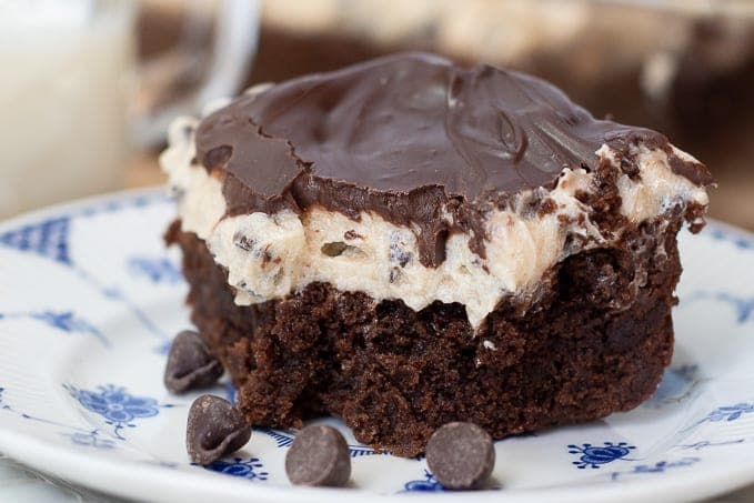 a close up shot of a cookie dough brownie with a bite taken out