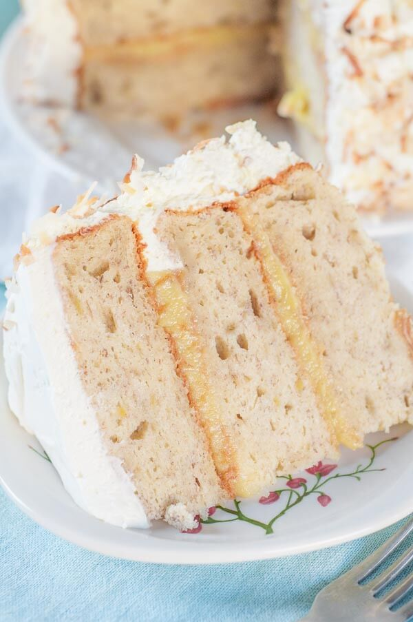 This Banana Cake with Fresh Banana Curd Cake recipe is has fluffy banana cake layers with a homemade fresh banana curd filling and whipped cream frosting. Welcome to cake heaven! http://www.mamagourmand.com