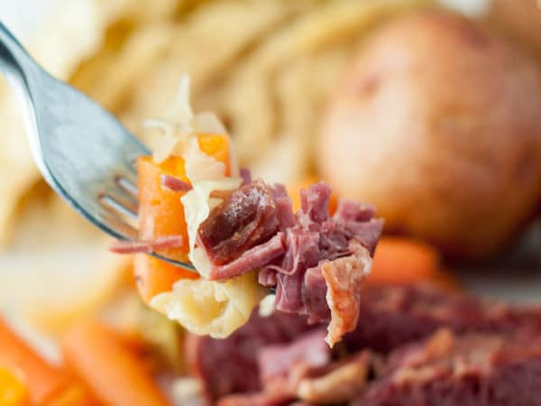 This Slow Cooker Apple and Brown Sugar Corned Beef and Cabbage recipe will be the best version you have ever tasted! Double the recipe because it's that good. www.mamagourmand.com
