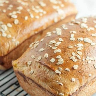 This Honey Oatmeal Bread recipe is an all-time favorite! It's light, airy, a touch sweet, and has a spongy crumb. It is an absolute perfect bread recipe! https://www.mamagourmand.com