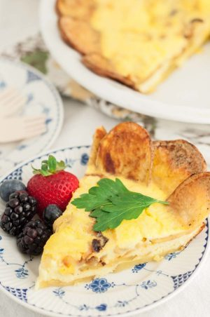 Potato Crusted Ricotta Frittata is a great gluten free recipe with a crispy potato shell and creamy ricotta eggs on top. It is a must have for dinner or breakfast! https://www.mamagourmand.com