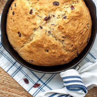 overhead shot of sweet Irish soda bread in a cast iron pan