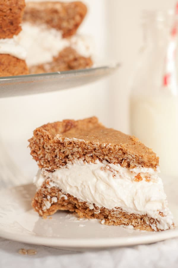 Gigantic Homemade Little Debbie's Oatmeal Cream Pie Cake recipe is a spot-on version with soft, chewy cookie layers and fluffy white filling sandwiched between. https://www.mamagourmand.com