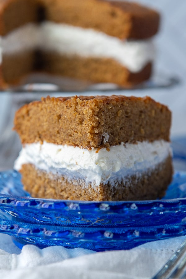 a slice of homemade oatmeal creme pie on a blue plate facing straight on
