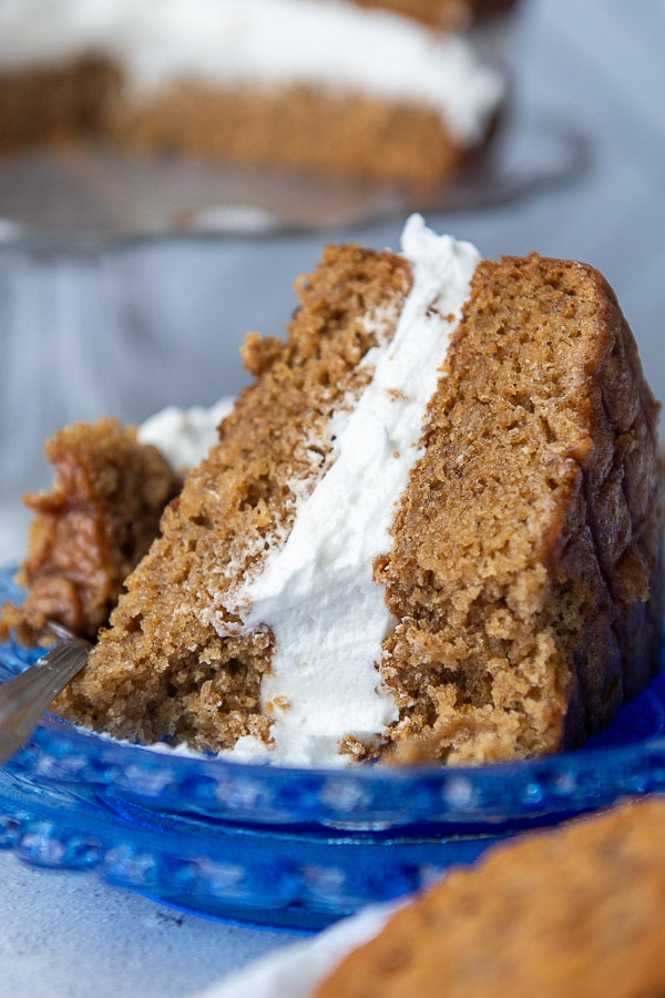 a slice of oatmeal cream pie cake on a blue plate with a bite taken out