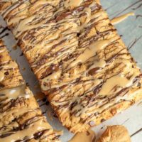 overhead shot of peanut butter bread with chocolate and peanut butter glazes drizzled over top