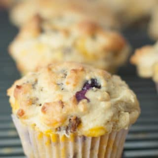 Blueberry Cheddar Sausage Muffins are a whole breakfast wrapped in one fantastic muffin recipe. The Blueberry Tea Maple Butter recipe also included is absolutely amazing spread on these warm, soft muffins. http://www.mamagourmand.com