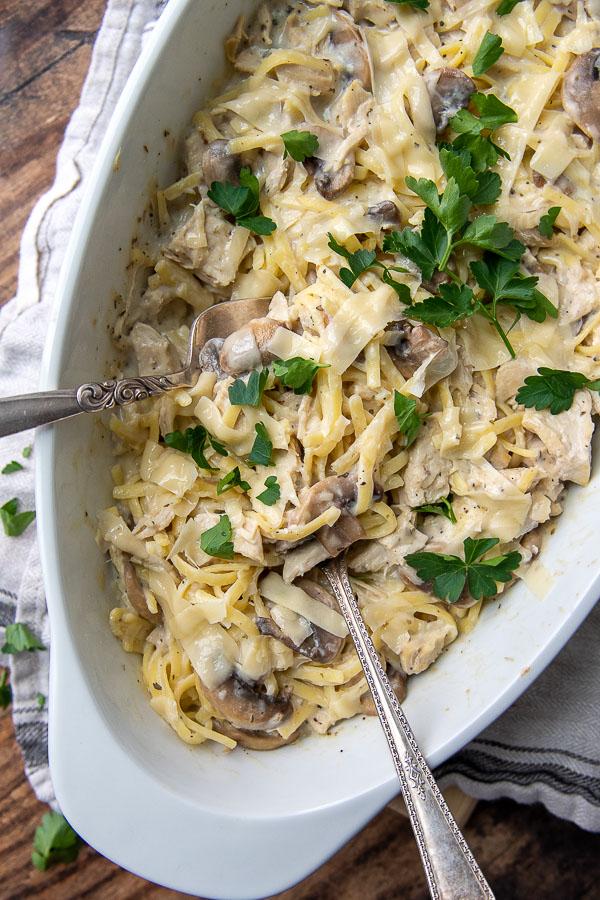 overhead shot of chicken tetrazzini casserole with serving utensils in it
