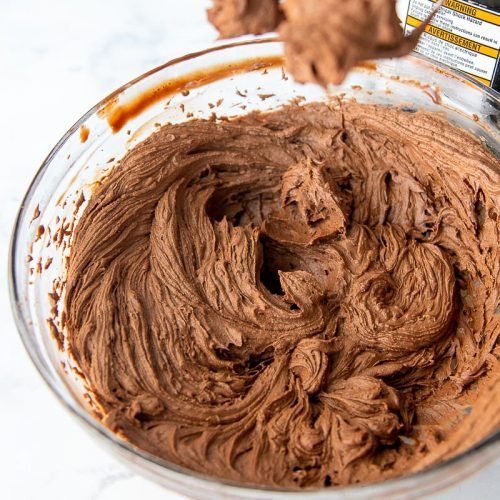 whipped chocolate ganache frosting in a mixing bowl