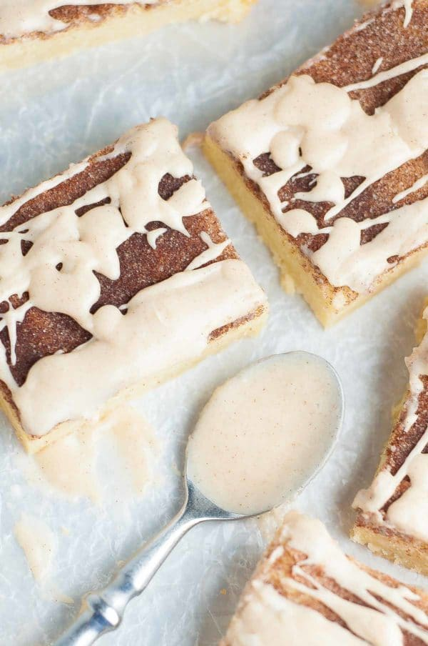 These Snickerdoodle Bars with Cinnamon Vanilla Glaze taste just like your favorite snickerdoodle cookie taken to the next level with a delicious gooey glaze drizzled all over. https://www.mamagourmand.com