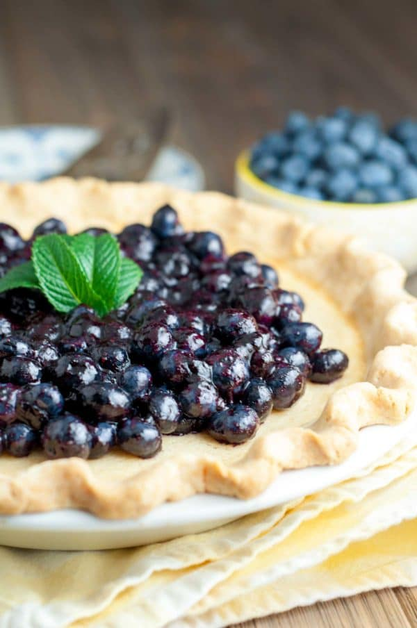 Fresh Blueberry Buttermilk Pie combines the creamy, sweet, tanginess of a buttermilk filling with a fresh blueberry topping. https://www.mamagourmand.com