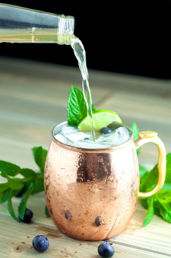 Blueberry Maple Moscow Mule is lightly sweetened with pure maple syrup and muddled fresh blueberries. It is a the perfect light, refreshing summer cocktail! https://www.mamagourmand.com