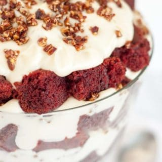 Delicious, moist red velvet cake trifle layered with a mascarpone whipped cream topping, and candied pecans will impress a crowd, but it's so easy to throw together! http://www.mamagourmand.com