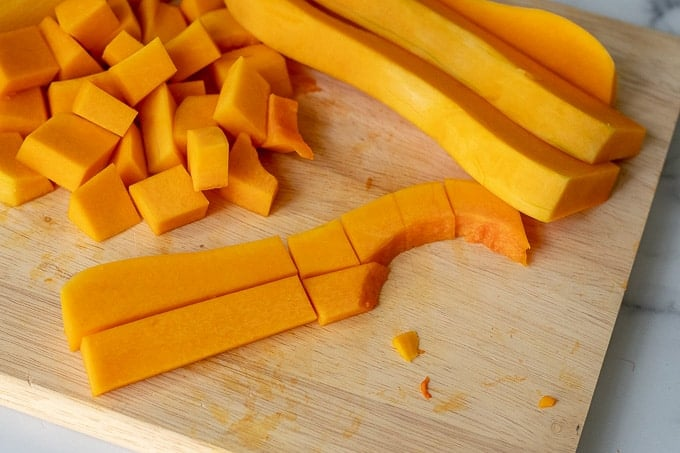 pictures showing how to cut a butternut squash