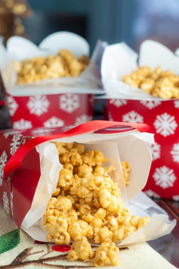 Mom's Easy Microwave Caramel Corn wrapped up in gift boxes for great holiday food gifts. https://www.mamagourmand.com