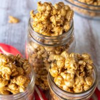 homemade caramel corn recipe in 3 glass jars