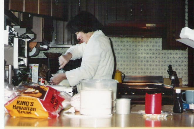 mom in her robe in the kitchen