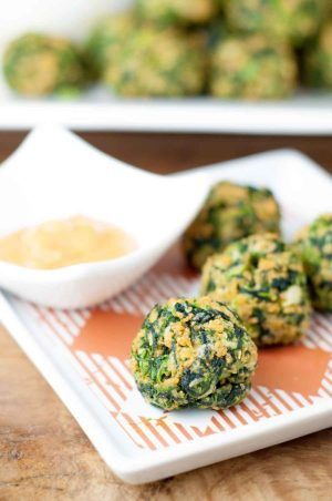 These Gluten Free Spinach Balls with Hot Sweet Mustard taste EXACTLY like the classic version and are the perfect gluten free appetizer everyone can enjoy. https://www.mamagourmand.com