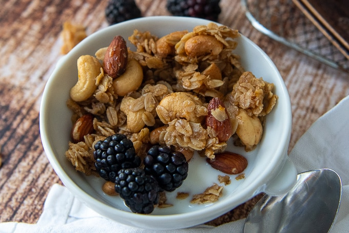 a close up of granola in a white bowl