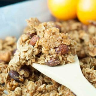Chewy Orange Spiced Granola is THE BEST GRANOLA I have ever tasted with a chewy texture, cinnamon, orange, nutmeg, and maple blended together. https://www.mamagourmand.com