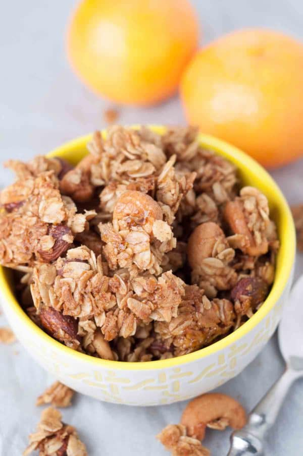 Chewy Orange Spiced Granola is so delicious you can snack on it without even adding milk or yogurt. https://www.mamagourmand.com