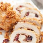 Cranberry Dijon Pretzel Chicken is pretzel-crusted baked chicken with bacon, cranberries, and honey dijon rolled inside. Even though it looks decadent, it is simple to throw together and a great, healthy weeknight dinner.