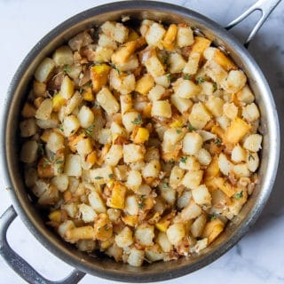potatoes, apples, and onions in a skillet
