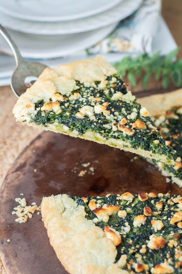 Spinach Cheese Galette Tart has a flaky, buttery crust wrapped around a spinach custard cheese filling and sprinkled with feta cheese. https://www.mamagourmand.com