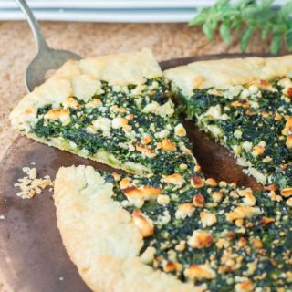 Spinach Cheese Galette Tart has a flaky, buttery crust wrapped around a spinach custard cheese filling and sprinkled with feta cheese.