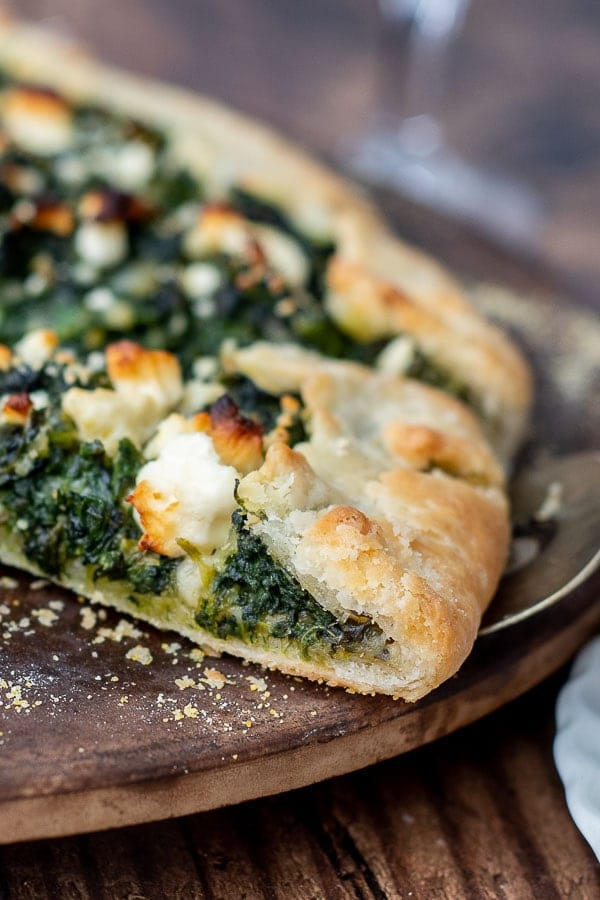 a close up of the crust of vegetable tart