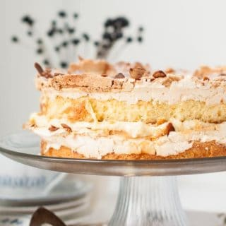 World's Best Blitz Torte is an explosion of textures and tastes with a crunchy, crackling top, chewy dense cake and a creamy, custard vanilla filling. https://www.mamagourmand.com