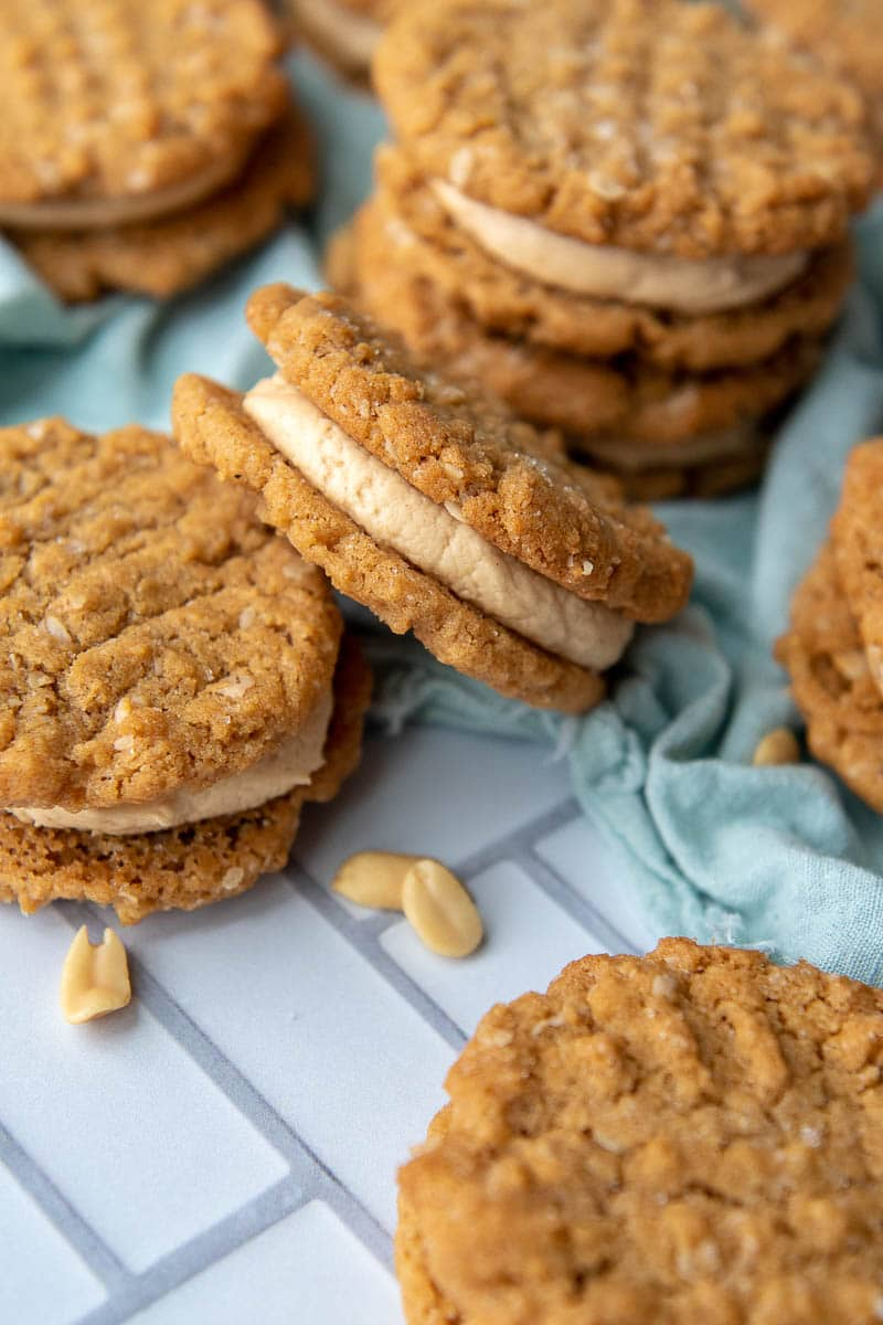 a cookie sandwich with peanut butter filling laying on its side