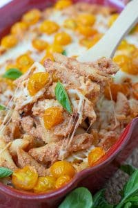 a wooden spoon scooping into easy baked pasta casserole