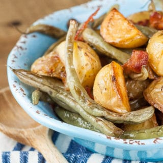 Bacon Roasted Green Beans and Potatoes is an effortless side dish that only takes minutes to prepare and yields perfectly crisp and flavorful vegetables. https://www.mamagourmand.com
