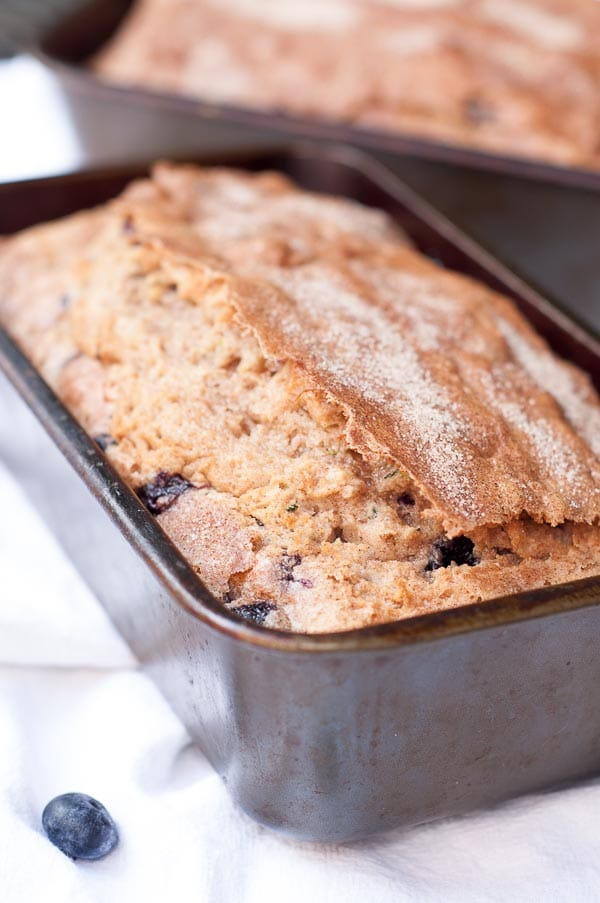 Blueberry Zucchini Quick bread combines healthy blueberries and zucchini in a moist quick bread with a cinnamon sugar crunchy topping. https://www.mamagourmand.com
