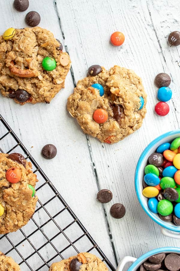 kitchen sink cookies on a cooling rack with a bowl of m&ms nearby