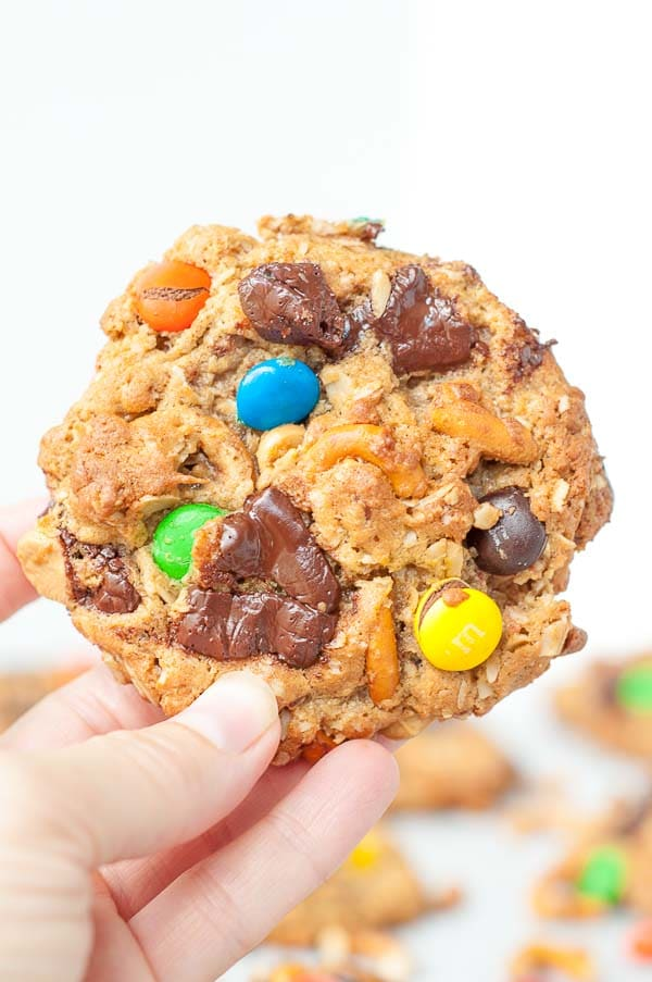 Soft Flourless Kitchen Sink cookies have oats, peanut butter, chocolate, pretzels, butterscotch, and M&Ms all wrapped up into one perfect chewy cookie recipe. https://www.mamagourmand.com