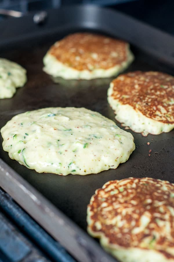 Only 4 simple ingredients stand in the way of making these Easy Gluten Free Zucchini Pancakes. They are, hands down, the best zucchini pancake recipe out there! https://www.mamagourmand.com