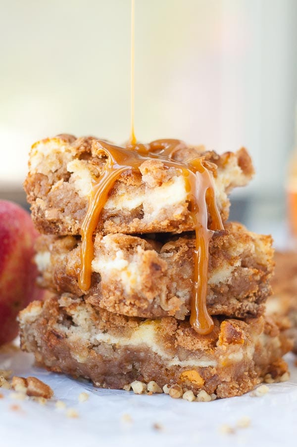 a stack of apple bars with caramel drizzled over top