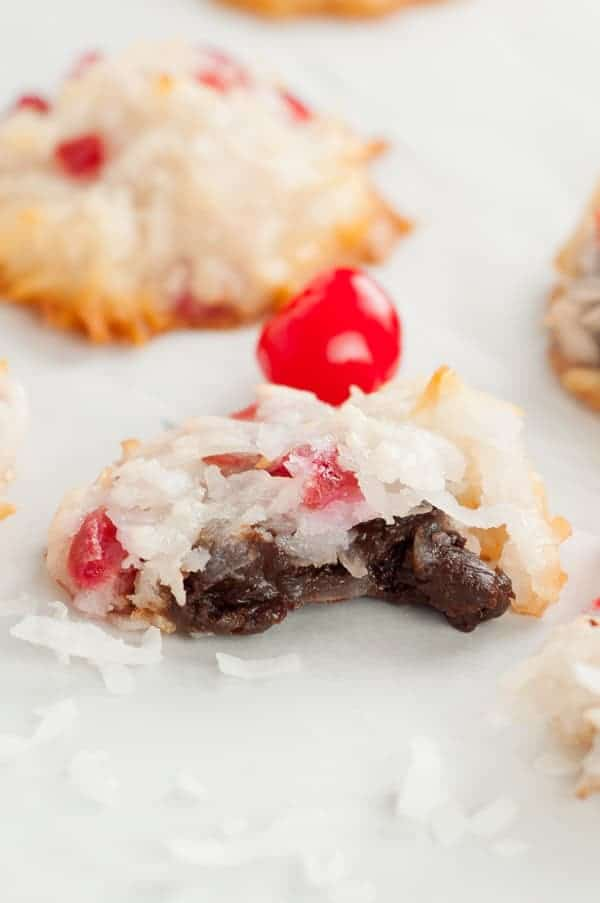 Chocolate Filled Cherry Coconut Macaroons have a fudgy, chocolate center surrounded by a simple, not overly sweet, toasted cherry coconut macaroon.