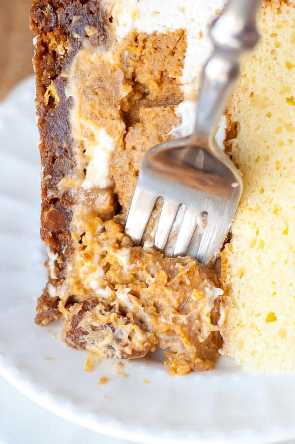 "A very close up shot of a fork going into Pumpkin Praline ""PieCaken"" Cake"
