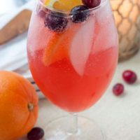 Sparkling Cranberry Orange Vodka Cocktail is a holiday cocktail drink with cranberry vodka, hint of orange, cranberry orange simple syrup, and a little fizz
