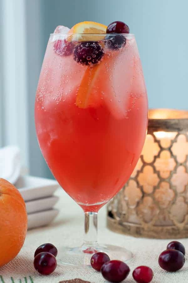a straight on shot of sparkling cranberry orange cocktail