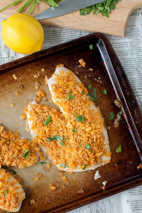 an overhead shot of oven fried fish on a baking sheet