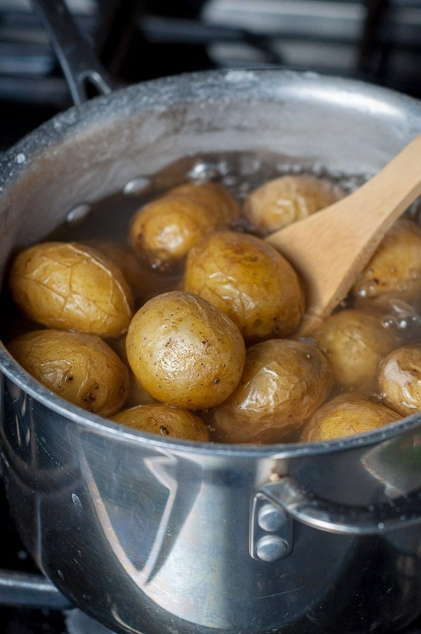 salt potatoes boiling in water on the stove