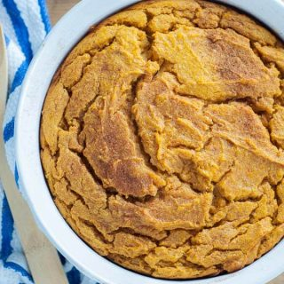 An overhead shot of Naturally Gluten Free Sweet Potato Spoon Bread in a white, round baking dish