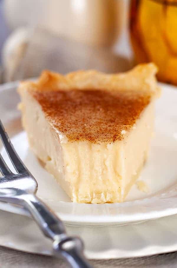 a close up shot of sugar cream pie with a bite taken out